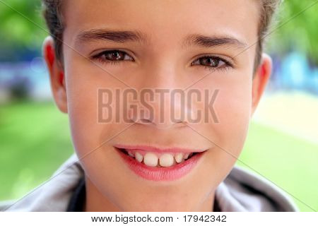 boy teenager closeup face macro happy smiling outdoor green garden