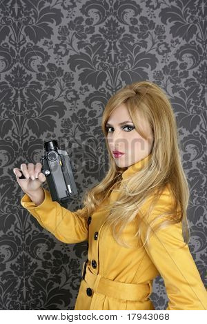 fashion Super 8mm camera reporter woman vintage wallpaper yellow coat