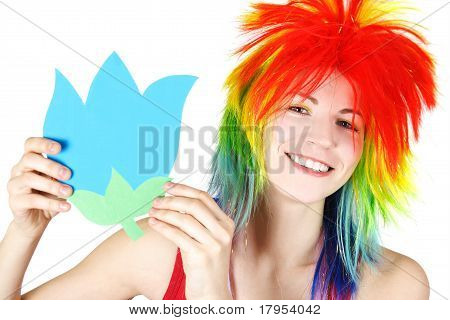 Young Beauty Woman In Multicolored Clown Wig Smiling And Holding Flower Cardboard, Isolated