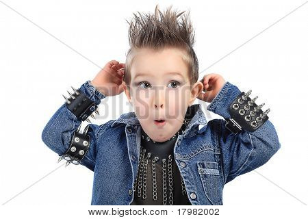 Shot of an emotional little boy wearing rock music clothes. Isolated over white background.