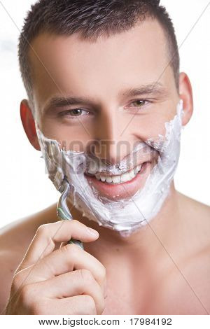 Shaving man with grin smile