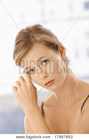 Portrait of serious woman thinking leaning to her hand.