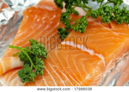 Raw salmon in foil