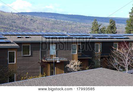 Solar panels on condominiums.