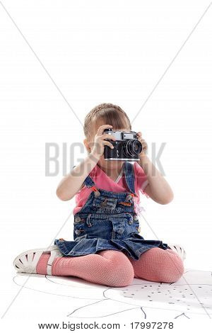 Child with old-style film photo camera