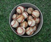 foto of bp  - a bucket of scruffy baseballs used for batting practice - JPG