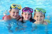 picture of swimming pool family  - Happy kids playing and having fun together in the pool - JPG