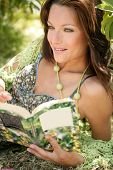 pic of girl reading book  - Beautiful woman reading happy a book in forest - JPG