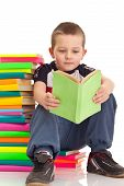 Little Boy Sitting On Books