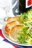foto of escarole  - Crusty toasts bottle of red wine and endive salad - JPG