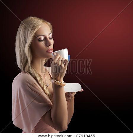 Blond Sensual Woman With White Tea Cup