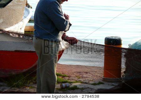 Fisherman And  Fishing Net