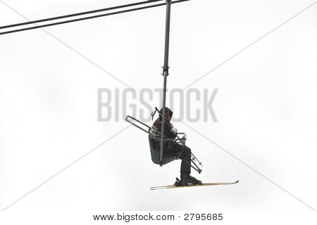 A Skier On A Chair Lift
