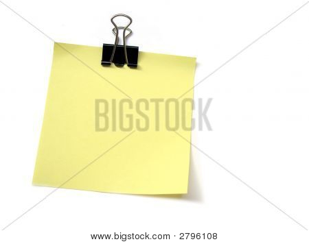 Papaer Clip Holding A Yellow Sticky Note