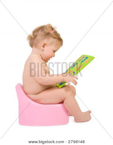 Baby Sit On Pink Potty And Look To Digits Toy
