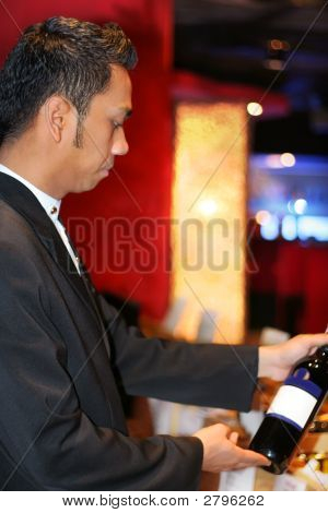 Butler Holding Red Wine Botle