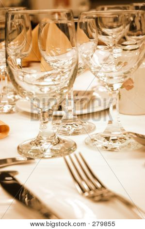 Wine Glasses In Warm Lighting