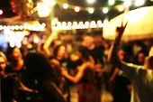 Blurred Background Of Many People Had Fun At A Beach Party. Festive Concept. poster