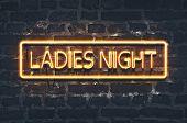 Ladies Night Neon Sign On Dark Brick Wall poster