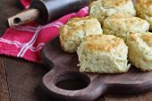 Freshly Baked Buttermilk Southern Biscuits Or Scones From Scratch Over Cutting Board. poster