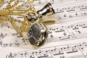 stock photo of christmas bells  - christmas bells and sheet music - JPG