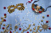 Venetian Carnival Mask, Confetti Stars And Party Streamers On Blue Background. Flat Lay Of Christmas poster