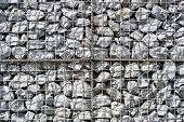 The Texture Of The Wall Of Small Gray Stones Under Iron Mesh. Natural Stone Wall Texture Photo, Ston poster