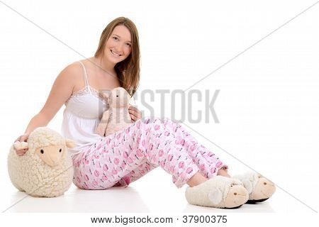 Teenager in pajamas with toy sheep