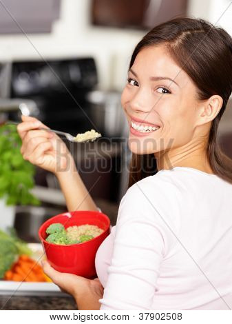 Woman Eating Quinoa Salad