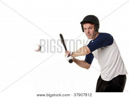 Baseball or softball Player Hitting a Ball