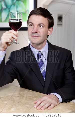 Man enjoying a Glass of Wine
