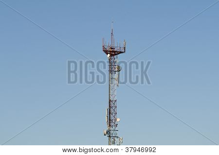 CELL PHONE TOWER ON A BLUE SKY