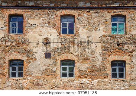 Old Orange Brick Wall With Six Windows
