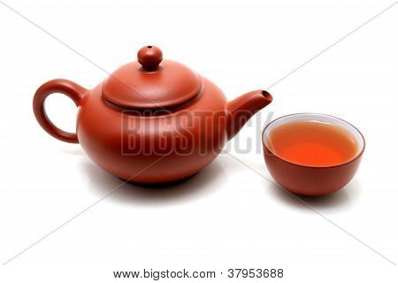 A Cup Of Tea And Teapot