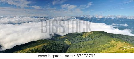 Natural Cloudy Valley In The Mountains