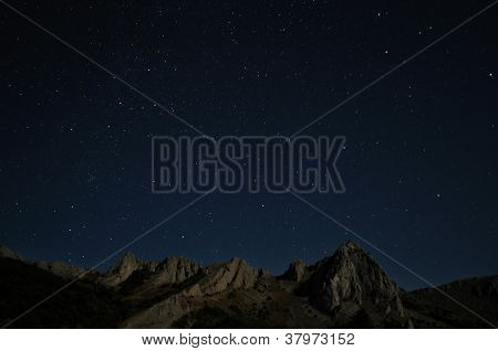 Natural Rocks And Stars At Night