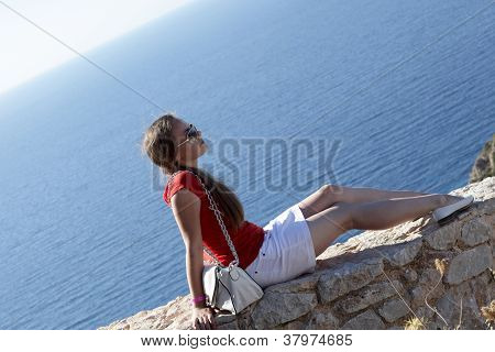 Teen Sitting On Wall Of Castle