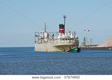 Tugboat And Freighter