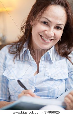 Latin Woman Taking Notes