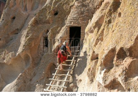 Woman Exploring Cliff Dwellings