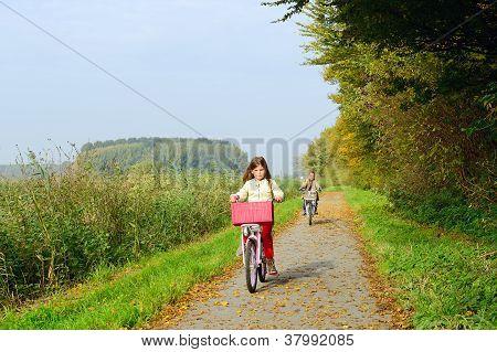 children enjoying nature on bicycle