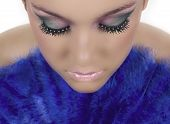 stock photo of makeup artist  - Girl with beautiful make up and rhinestones on her eye lashes - JPG