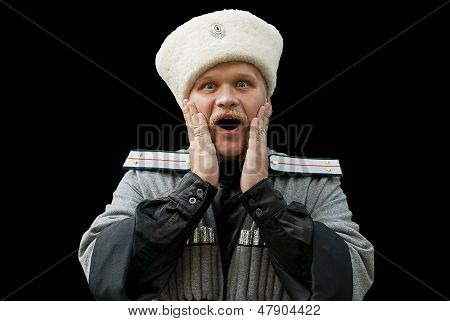 Surprised young man in a cossack clothes