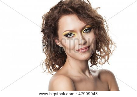 Beautiful young girl with curly hair and modern bright makeup