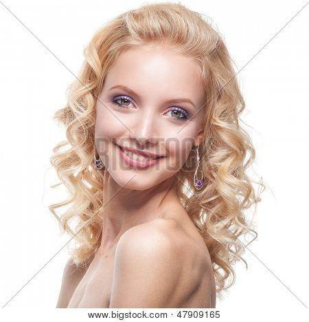 Face of a smiling young caucasian woman with curly blond hair
