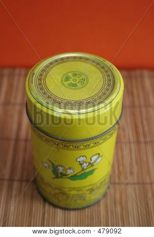 Old Chinese Tea Tin On Bamboo - Copy Space