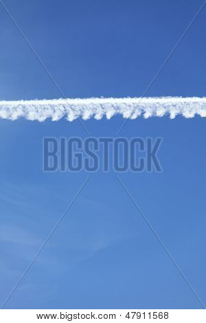 Airplane Tracks In The Blue Sky
