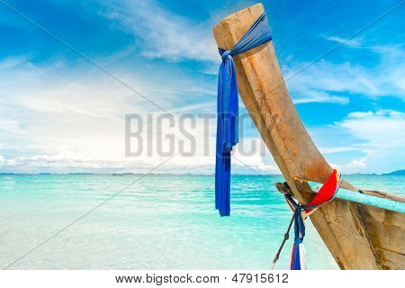 long boat, blue sky, clear water in Thailand
