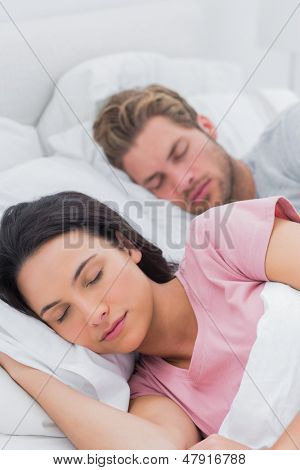 Peaceful beautiful couple sleeping in bed