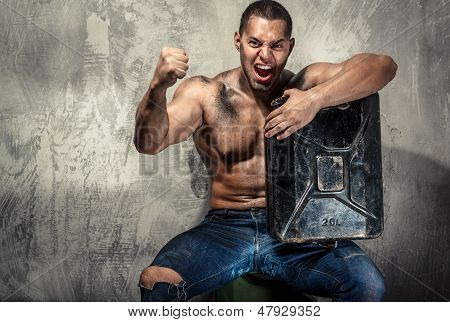Muscular Man With Metal Fuel Can Indoors